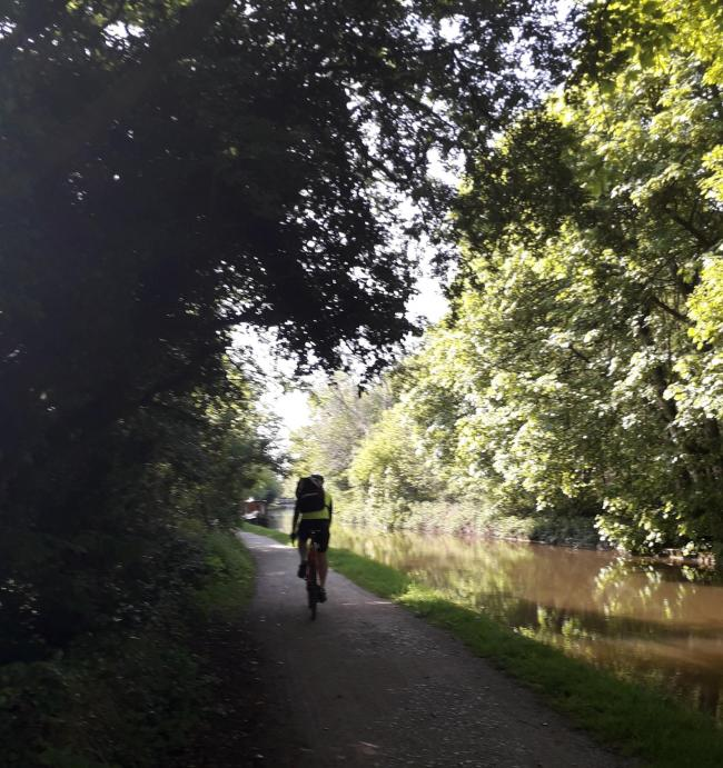 A cyclist on the Leeds and Liverpool Canal towpath (photo: Amy Clough)