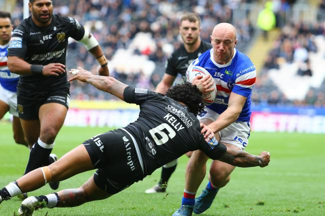 Lee Kershaw, pictured in action against Hull's Albert Kelly, has signed a new Wakefield deal  Picture:Ash Allen/SWpix.com