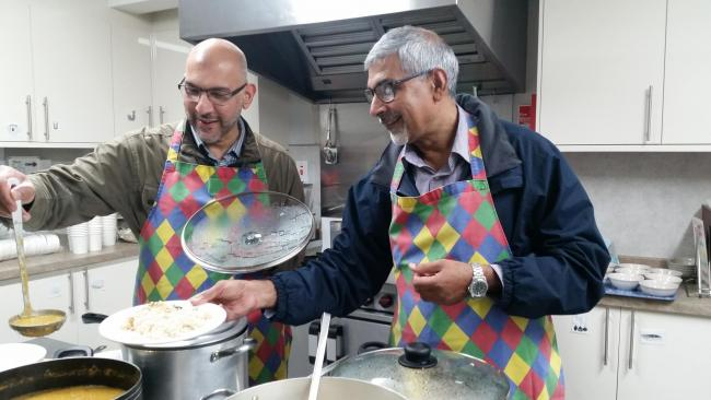 Ahmadiyya Muslim Elders Association members at work in the kitchen
