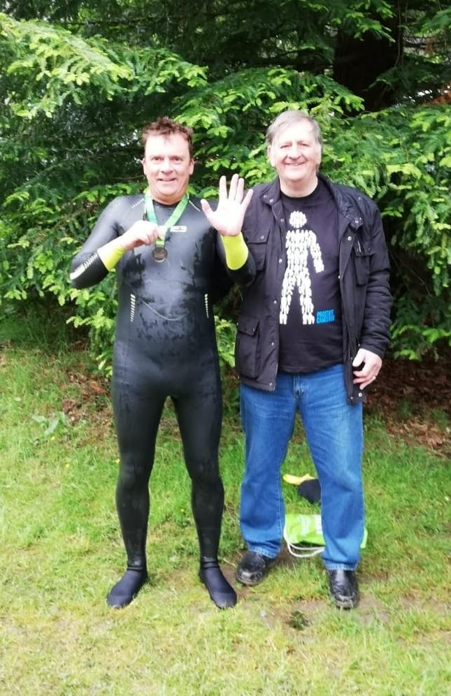 Andrew Davy, pictured with his father Derek before swimming Windermere during the Great North Swim